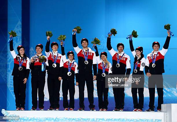 Silver medalists Kaetlyn Osmond, Patrick Chan, Kevin Reynolds, Meagan Duhamel, Eric Radford, Kirsten Moore-Towers, Dylan Moscovitch, Tessa Virtue and...