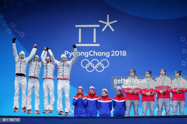 Silver medalists Karl Geiger Stephan Leyhe Richard Freitag and Andreas Wellinger of Germany gold medalists Daniel Andre Tande Andreas St Jernen...