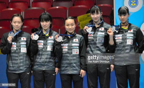 Silver medalists Kasumi Ishikawa Miu Hirano Mima Ito Hina Hayata and Miyu Nagasaki of Japan pose for photographs during the medal ceremony for the...