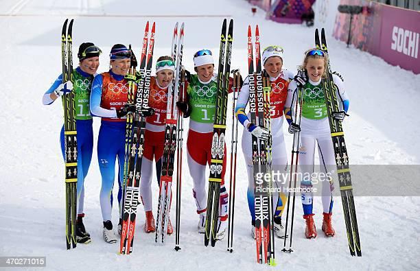 Silver medalists Kerttu Niskanen of Finland AinoKaisa Saarinen of Finland gold medalists Ingvild Flugstad Oestberg of Norway Marit Bjoergen of Norway...
