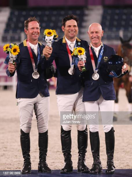 Silver medalists Kevin McNab, Shane Rose and Andrew Hoy of Team Australia pose with their silver medals during the Eventing Jumping Team medal...