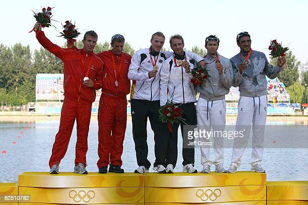 Silver medalists Kim Wraae Knudsen and Rene Holten Poulsen of Denmark gold medalists Martin Hollstein and Andreas Ihle of Germany and bronze...