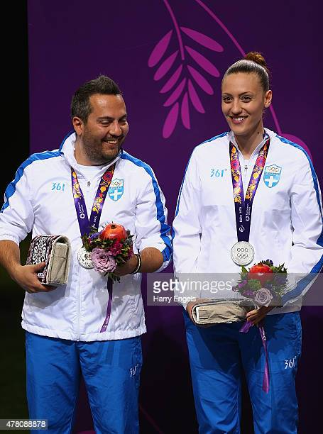 Silver medalists Konstantinos Malgarinos and Anna Korakaki of Greece pose with the medals won during the Shooting Mixed Team 10m Air Pistol finals on...
