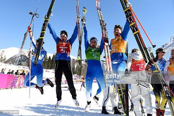 Silver medalists Krista Lahteenmaki Anne Kylloenen AinoKaisa Saarinen and Kerttu Niskanen of Finland celebrate after the Women's 4 x 5 km Relay...