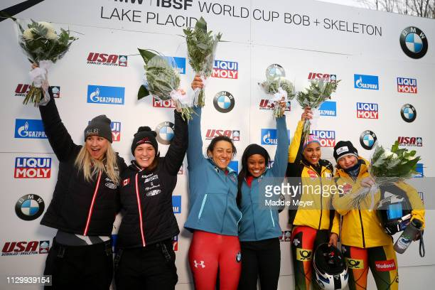 Silver medalists Kristen Bujnowski and Christine de Bruin of Canada gold medalists Elana Meyers Taylor and Lake Kwaza of the United States and bronze...