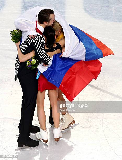 Silver medalists Ksenia Stolbova and Fedor Klimov of Russia gold medalists Tatiana Volosozhar and Maxim Trankov of Russia celebrate during the flower...