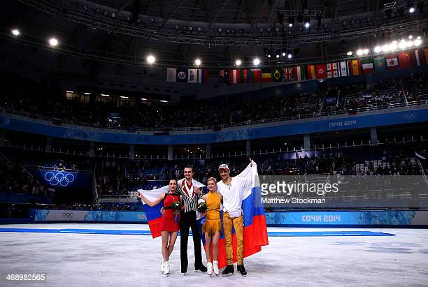 Silver medalists Ksenia Stolbova and Fedor Klimov of Russia gold medalists Tatiana Volosozhar and Maxim Trankov of Russia pose during the flower...