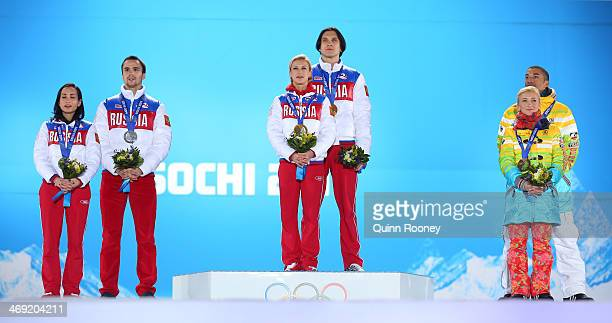 Silver medalists Ksenia Stolbova and Fedor Klimov of Russia gold medalists Tatiana Volosozhar and Maxim Trankov of Russia bronze medalists Aliona...