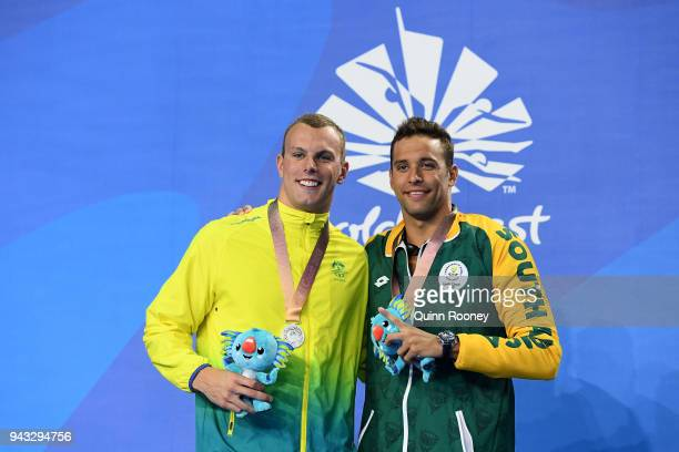Silver medalists Kyle Chalmers of Australia and Chad le Clos of South Africa pose during the medal ceremony for the Men's 100m Freestyle Final on day...