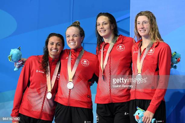 Silver medalists Kylie Masse Kierra Smith Penny Oleksiak and Taylor Ruck of Canada pose during the medal ceremony for the Women's 4 x 100m Medley...