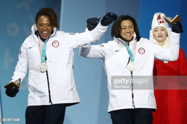 Silver medalists Lauren Gibbs and Elana Meyers Taylor of the United States celebrate during the medal ceremony for Bobsleigh Women on day 13 of the...