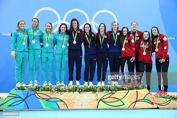 Silver medalists Leah Neale Emma McKeon Bronte Barratt and Tamsin Cook of Australia Gold medalists Allison Schmitt Leah Smith Maya Dirado and Katie...