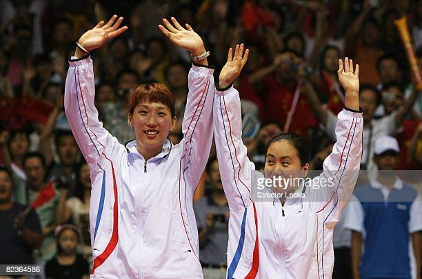 Silver medalists Lee Hyojung and Lee Kyungwon of South Korea wave to the crowd after the Women's Doubles at the Beijing University of Technology...