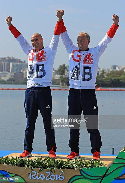 Silver medalists Liam Heath and Jon Schofield of Great Britain stand on the podium during the medal ceremony for the Men's Kayak Double 200m event at...