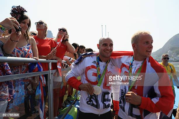 Silver medalists Liam Heath and Jon Schofield of Great Britain celebrate during the medal ceremony for the Men's Kayak Double 200m event at the Lagoa...