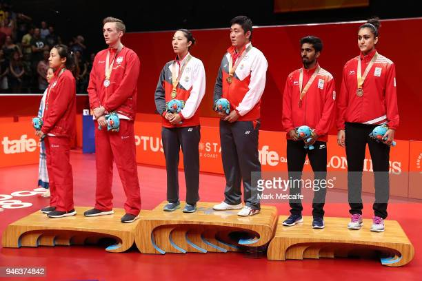 Silver medalists Liam Pitchford and TinTin Ho of England gold medalists Ning Gao and Mengyu Yu of Singapore and bronze medalists Sathiyan...