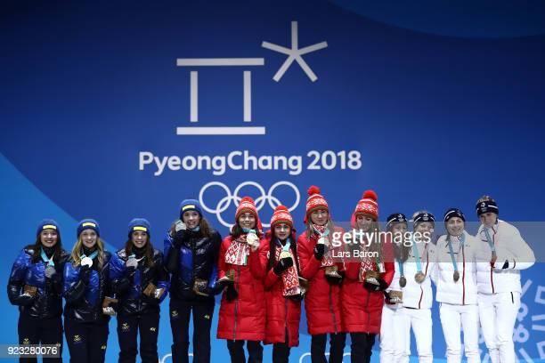 Silver medalists Linn Persson, Mona Brorsson, Anna Magnusson and Hanna Oeberg of Sweden, gold medalists Nadezhda Skardino, Iryna Kryuko, Dzinara...