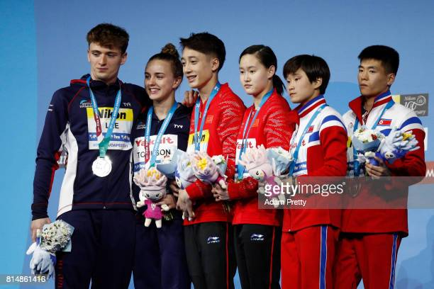 Silver medalists Lois Toulson and Matthew Lee of Great Britain gold medalist Qian Ren and Junjie Lian of China and bronze medalist Mi Rae Kim and...