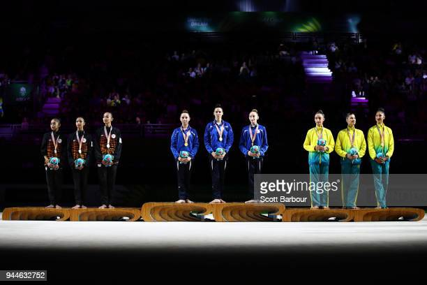 Silver medalists Malaysia, gold medalists Cyprus and bronze medalists Australia pose during the medal ceremony for the Rhythmic Gymnastics on day...
