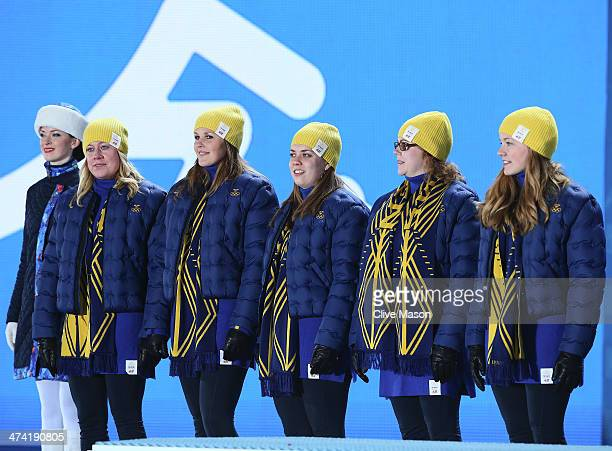 Silver medalists Maria Prytz Christina Bertrup Maria Wennerstrom Margaretha Sigfridsson and Agnes Knochenhauer of Sweden celebrate during the medal...