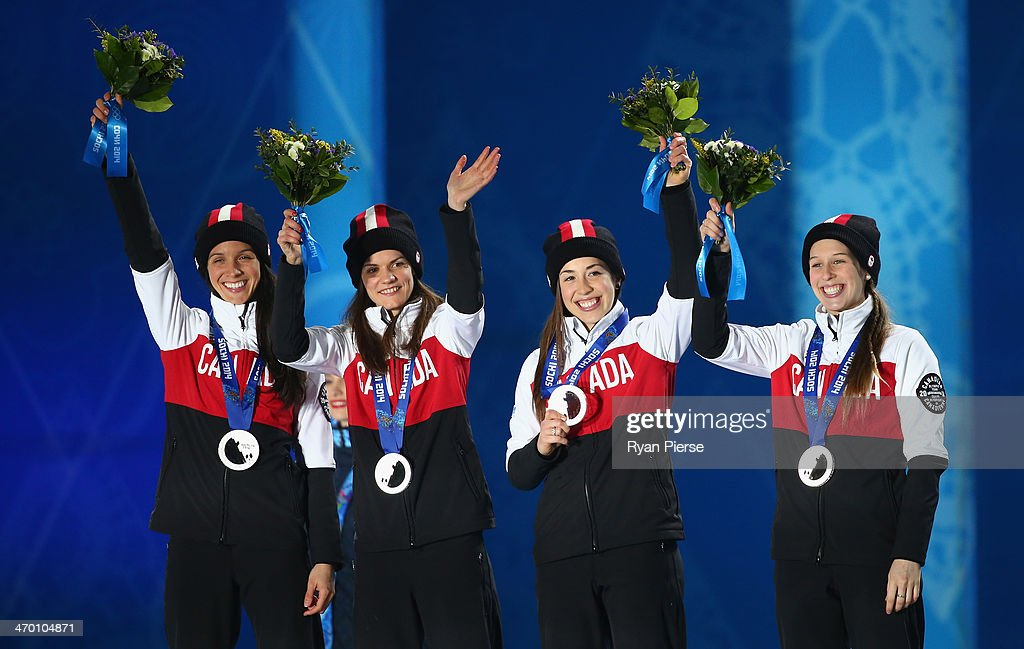 Silver medalists (L-R) Marie-Eve Drolet, Jessica Hewitt, Valerie Maltais and Marianne St. Gelais of Canada celebrate on the podium during the medal ceremony for the Short Track Ladies' 3000m Relay on day 11 of the Sochi 2014 Winter Olympics at Medals Plaza on February 18, 2014 in Sochi, Russia.