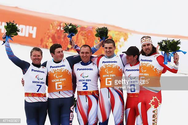 Silver medalists, Mark Bathum and his guide Cade Yamamoto of USA, gold medalists, Jakub Krako and his guide Martin Motyka of Slovakia, Bronze...