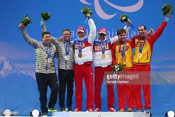Silver medalists Mark Bathum of the United States and guide Cade Yamamoto , Gold medalists Valerii Redkozubov of Russia and guide Evgeny Geroev and...
