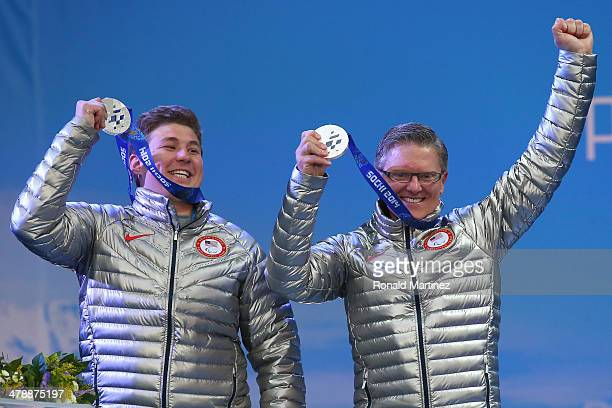 Silver medalists Mark Bathum of the Untied States and guide Cade Yamamoto celebrate at the medal ceremony for men's Super Combined Visually Impaired...