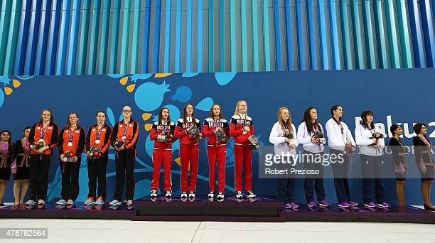 R Silver medalists Marrit Steenbergen Marieke Tienstra Frederique Janssen and Laura van Engelen of Netherlands gold medalists Arina Openysheva...