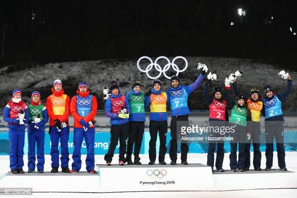 Silver medalists Marte Olsbu, Tiril Eckhoff, Johannes Thingnes Boe and Emil Hegle Svendsen of Norway, gold medalists Marie Dorin Habert, Anais...