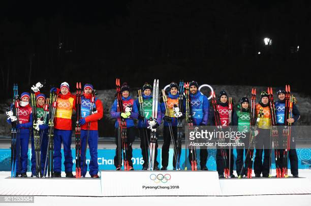 Silver medalists Marte Olsbu Tiril Eckhoff Johannes Thingnes Boe and Emil Hegle Svendsen of Norway gold medalists Marie Dorin Habert Anais Bescond...