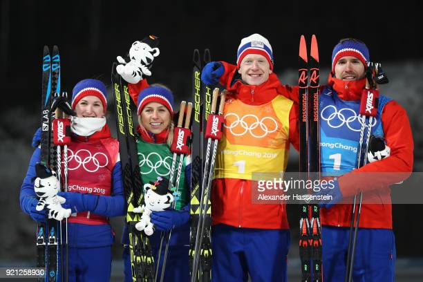 Silver medalists Marte Olsbu Tiril Eckhoff Johannes Thingnes Boe and Emil Hegle Svendsen of Norway celebrate during the victory ceremony after the...