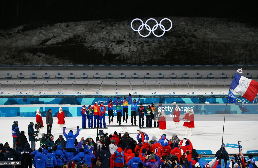 Silver medalists Marte Olsbu, Tiril Eckhoff, Johannes Thingnes Boe and Emil Hegle Svendsen of Norway, gold medalists Marie Dorin Habert, Anais Bescond, Simon Desthieux and Martin Fourcade of France and bronze medalists Lisa Vittozzi, Dorothea Wierer, Lukas Hofer and Dominik Windisch of Italy celebrate during the victory ceremony after the Biathlon 2x6km Women + 2x7.5km Men Mixed Relay on day 11 of the PyeongChang 2018 Winter Olympic Games at Alpensia Biathlon Centre on February 20, 2018 in Pyeongchang-gun, South Korea.