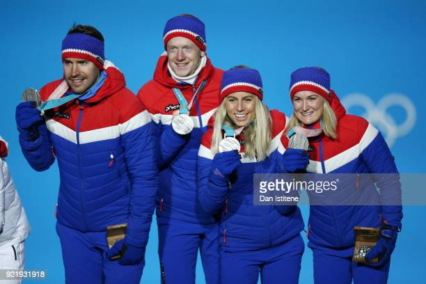 Silver medalists Marte Olsbu Tiril Eckhoff Johannes Thingnes Boe and Emil Hegle Svendsen of Norway celebrate during the medal ceremony for the...