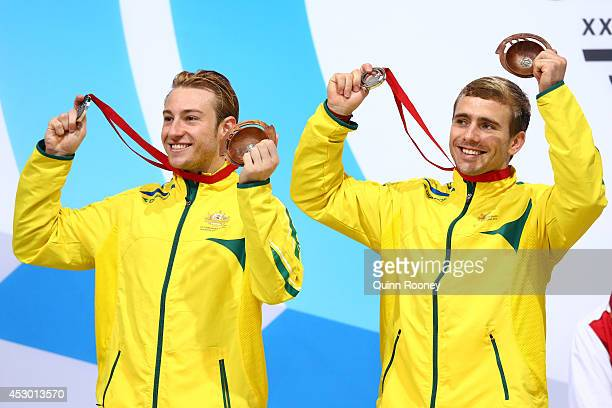 Silver medalists Matthew Mitcham and Grant Nel of Australia pose during the medal ceremony for the Men's Synchronised 3m Springboard Final at Royal...