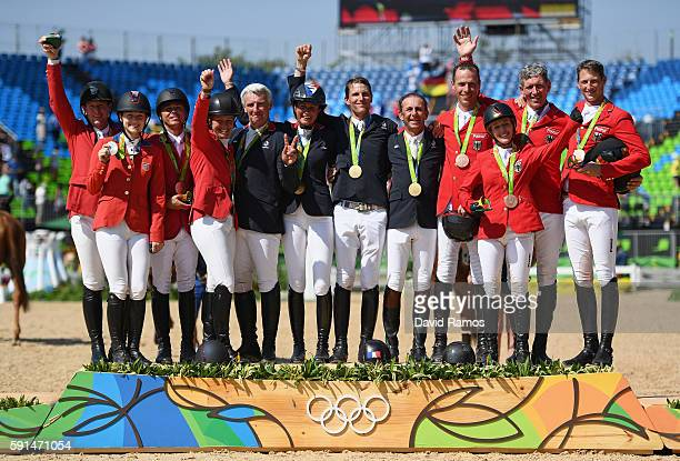 Silver medalists McLain Ward of United States riding Azur, Lucy Davis of United States riding Barron, Kent Farrington of the United States riding...