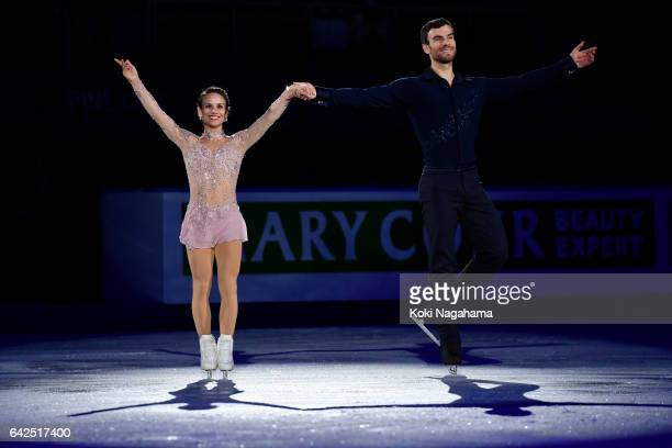 Silver medalists Meagan Duhamel and Eric Radford of Canada wave for fans prior to the medals ceremony of the Pairs during ISU Four Continents Figure...