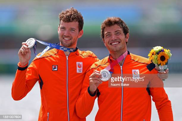 Silver medalists Melvin Twellaar and Stef Broenink of Team Netherlands pose with their medals during the medal ceremony for the Men's Double Sculls...