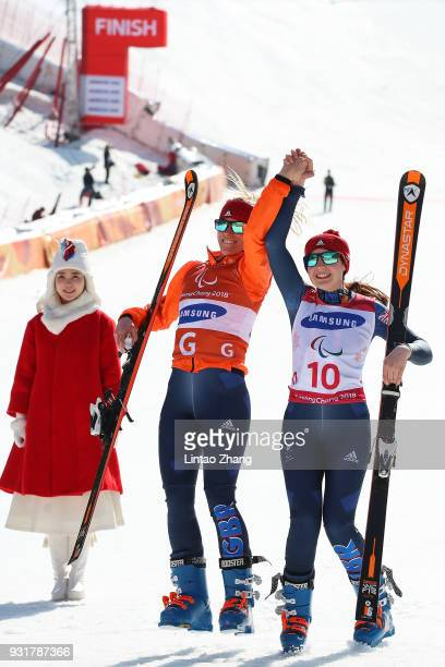 Silver Medalists Menna Fitzpatrick of Great Britain celebrates with her guide Jennifer Kehoe after the Women's Giant Slalom Run 2 Visually Impaired...