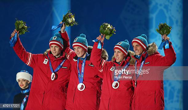 Silver medalists Michael Hayboeck Thomas Morgenstern Thomas Diethart and Gregor Schlierenzauer of Austria celebrate during the medal ceremony for the...