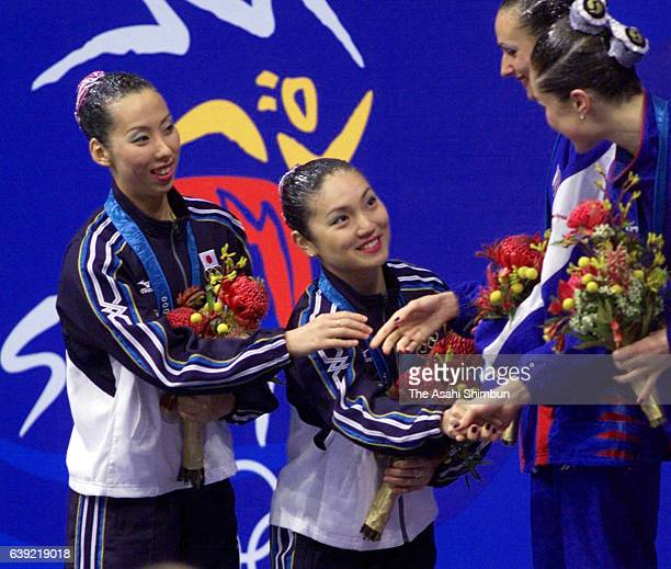 Silver medalists Miya Tachibana and Miho Takeda of Japan shake hands with gold medalistsOlga Brusnikina and Mariya Kiselyova of Russia at the medal...