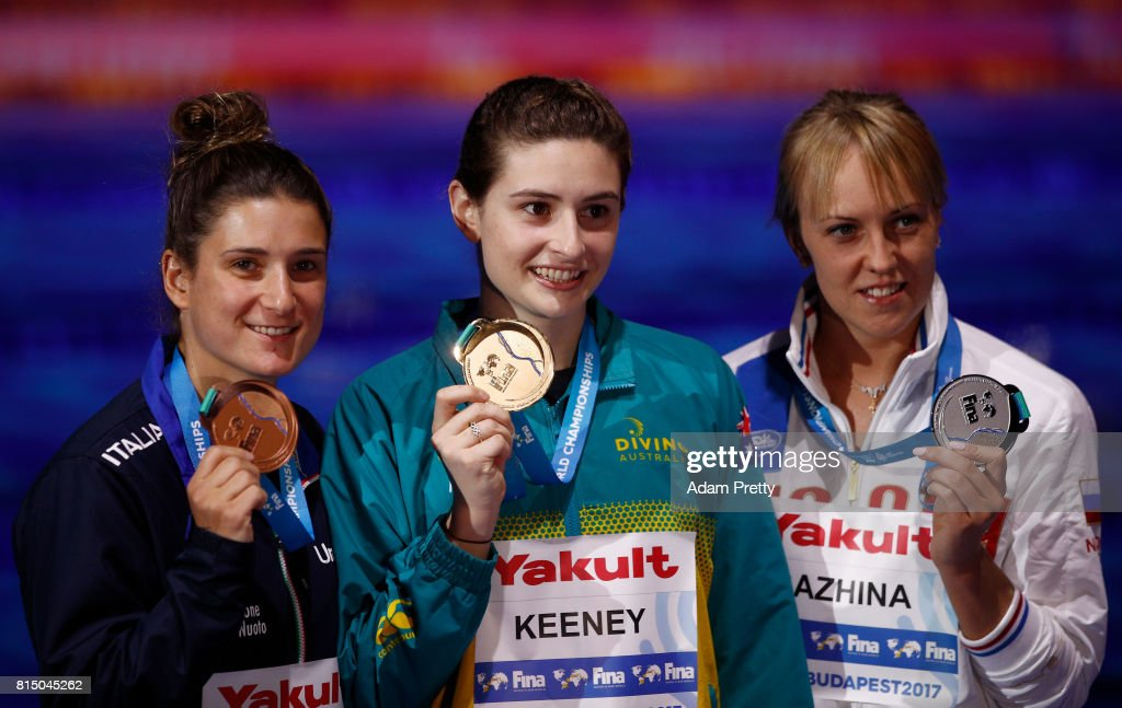 Silver medalists Nadezhda Bazinha of Russia gold Maddison Keeney of Australia and bronze medalist Elena Bertocchi of Italy pose with their medals following the Womens Diving 1m Springboard Final on day two of the Budapest 2017 FINA World Championships on July 15, 2017 in Budapest, Hungary.