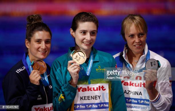 Silver medalists Nadezhda Bazinha of Russia gold Maddison Keeney of Australia and bronze medalist Elena Bertocchi of Italy pose with their medals...