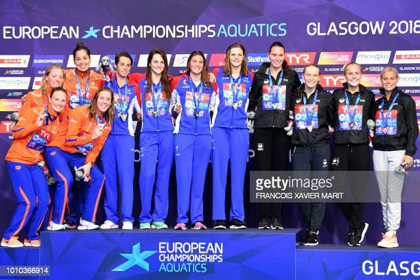 Silver medalists Netherlands' Kim AnnaLisa Busch Netherlands' Femke Heemskerk Netherlands' Kira Marije Toussaint and Netherlands' Ranomi Made...