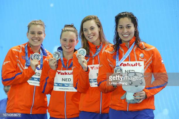 Silver medalists Netherlands team from left Valerie Van Roon Kim Busch Femke Heemskerk and Ranomi Kromowidjojo pose with their medals during...