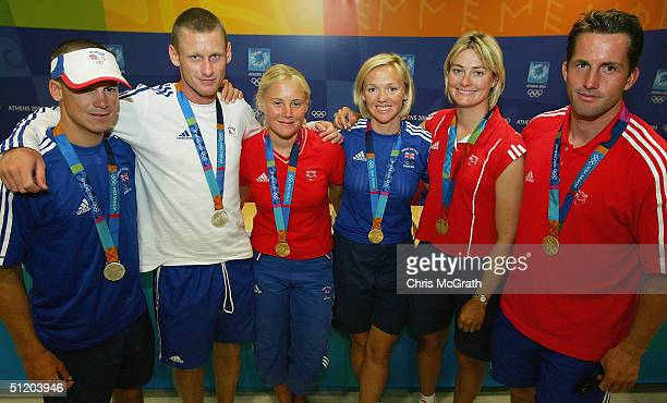 Silver medalists Nick Rogers and Jo Glanfield and gold medallists Sarah Ayton Shirley Robertson Sarah Webb and Ben Ainslie of Great Britain attend a...