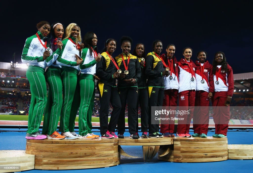 Silver medalists Nigeria, gold medalists Jamaica and bronze medalists England pose on the podium during the medal ceremony for the Women's 4x100 metres relay at Hampden Park during day ten of the Glasgow 2014 Commonwealth Games on August 2, 2014 in Glasgow, United Kingdom.