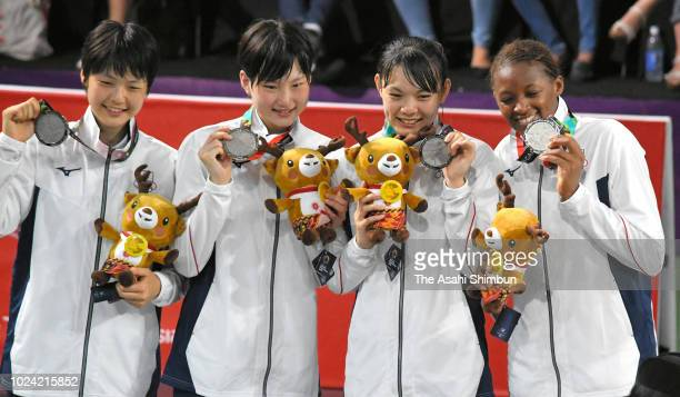 Silver medalists Norika Konno, Ririka Okuyama, Kiho Miyashita and Stephanie Mawuli of Japan celebrate on the podium at the medal ceremony for the...