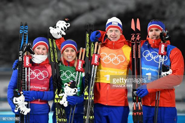 Silver medalists Norway's Marte Olsbu Norway's Tiril Eckhoff Norway's Tarjei Boe Norway's Emil Hegle Svendsen celebrate on the podium during the...