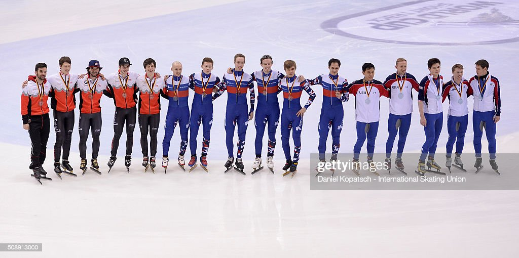 Silver medalists of Canada (L-R), gold medalists of Russia and bronze medalists of the United States pose during the Men 5000 M Relay medal ceremony during day two of the ISU World Cup Short Track Speed Skating at EnergieVerbund Arena on February 7, 2016 in Dresden, Germany.